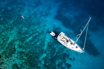 amazing view to yacht, swimming woman and clear water caribbean