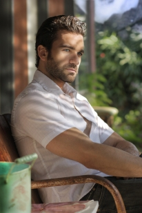 Portrait of a great looking masculine man relaxing on a front po