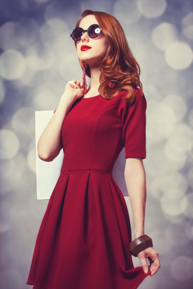 Beautiful redhead women with bag and bokeh at background