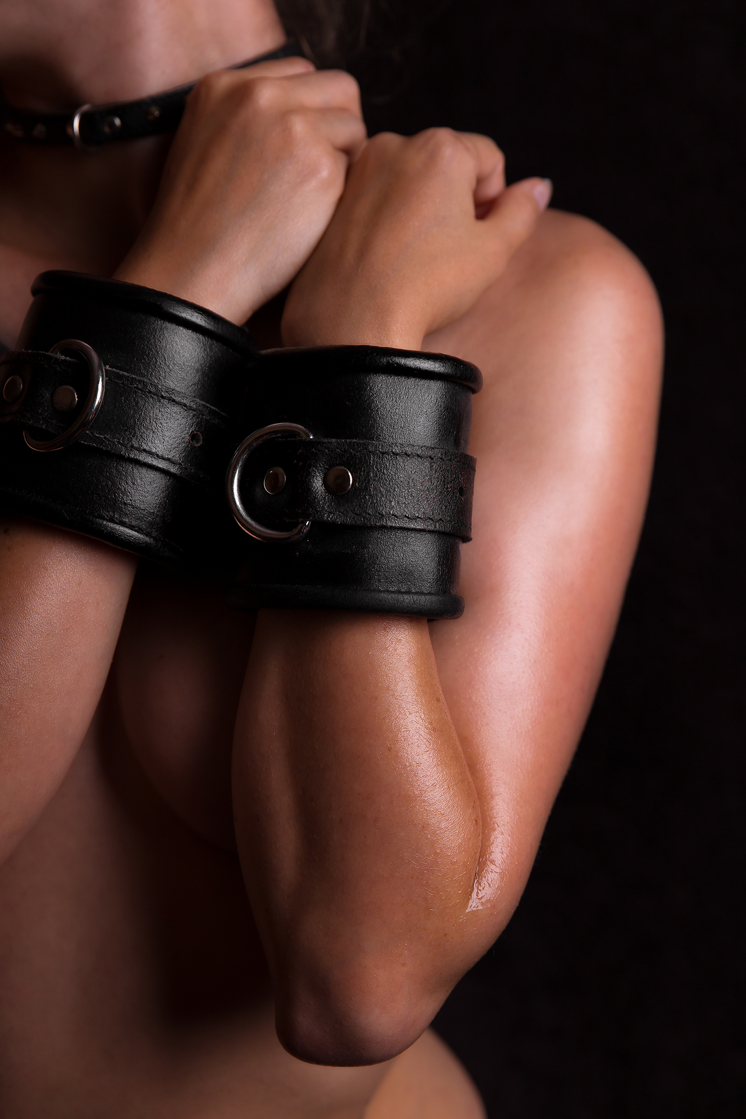 Naked Body With Leather Handcuffs