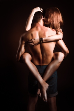 Passionate embraces men and women with black background