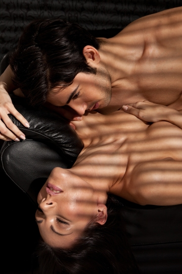 Ecstacy Of Love. Attractive young lovers enjoying sexual foreplay, facial expressions.
